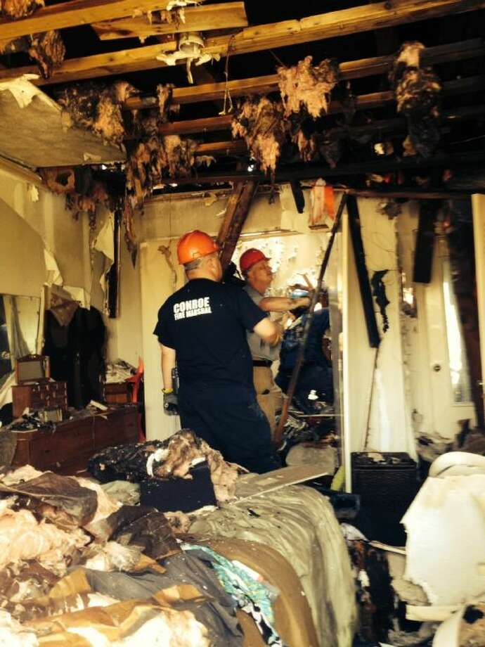 Fire officials spent Monday sorting through the debris of the fire at a Lake Conroe condominium complex over the weekend. Investigators are trying to determine the origin of the fire before they can look into what caused the blaze.