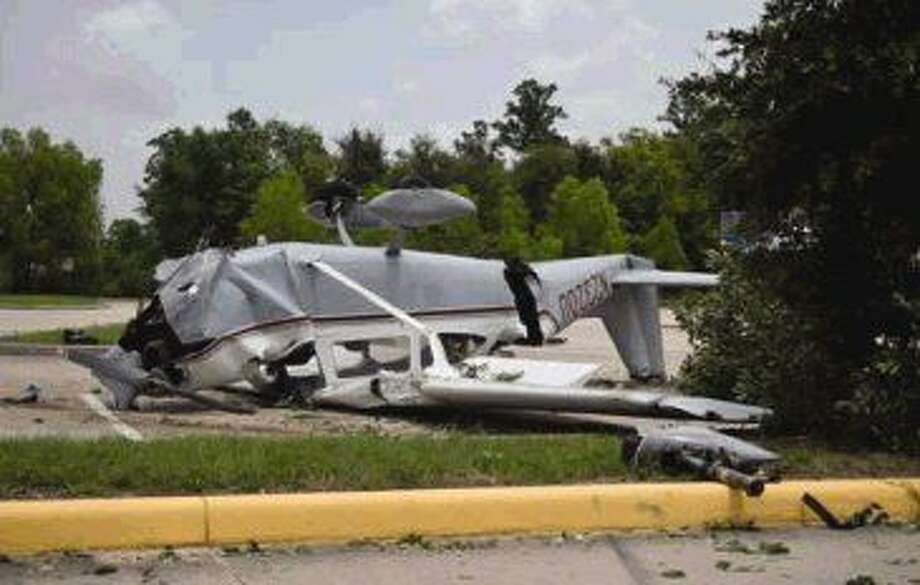 A plane crashed in the Woodforest Stadium parking lot in Shenandoah Friday. The pilot walked away with minor injuries. Photo: Adubois