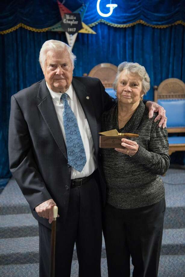 Jack Curtis and his wife, Peggy pose with the 2016 Golden Trowel Award given to Mr. Curtis a member of the lodge by the San Jacinto Masonic Lodge #106 A.F. & A.M. in Willis. The award is given out annually to a fellow mason in recognition of his service to his lodge, fellow brothers, and within the community.The Golden Trowel Award is the lodge's formal recognition of a brother for his devoted service to his Masonic principals in general. It is intended for the brother who year after year, quietly, but actively demonstrates his devotion to the teachings of masonry without the recognition or special honors. Photo: Jerry Johnston