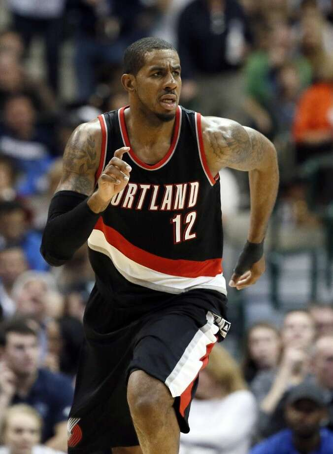 In this file photo, Portland Trail Blazers' LaMarcus Aldridge runs up court during an NBA against the Dallas Mavericks in February. Aldridge signed with the San Antonio Spurs on Saturday. Photo: Tony Gutierrez