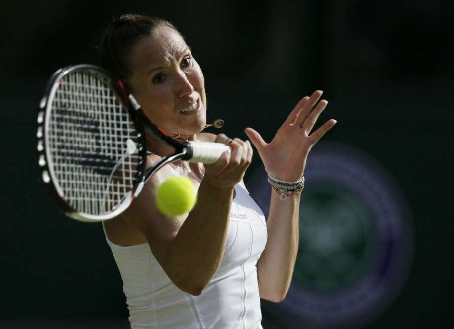 Jelena Jankovic of Serbia returns a ball to Petra Kvitova of the Czech Republic during their singles match at the All England Lawn Tennis Championships in Wimbledon, London, Saturday. Photo: Tim Ireland