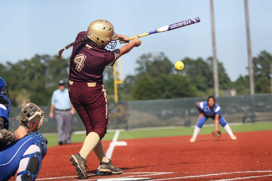 Magnolia West's Lauren Martinez (4) makes contact while at bat during high school softball playoff game one against Barbers Hill at Scrap Yard Sports.