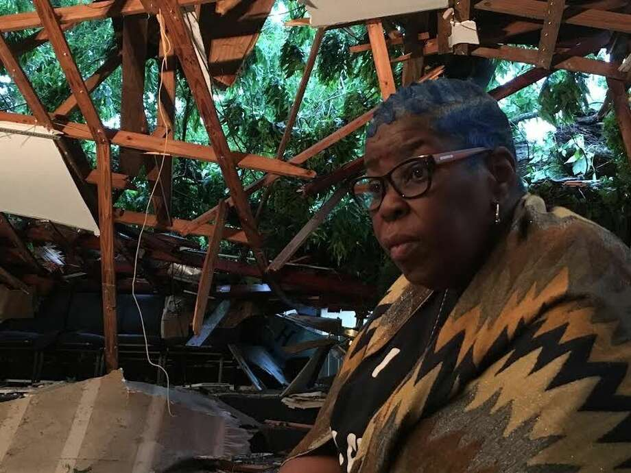 "Conroe resident and member Danda Crawford described the experience as ""very emotional"" after a Pecan tree crashed throguh Hopewell Church located at 504 Ave F in Conroe on Thursday night."