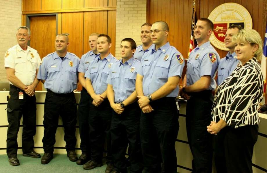 Tomball mayor Gretchen Fagan (right) and Tomball Fire Chief Randy Parr welcome new firefighters to the Tomball Fire Department at the Tomball City Council Meeting on Nov. 5 Photo: Mary Bailey
