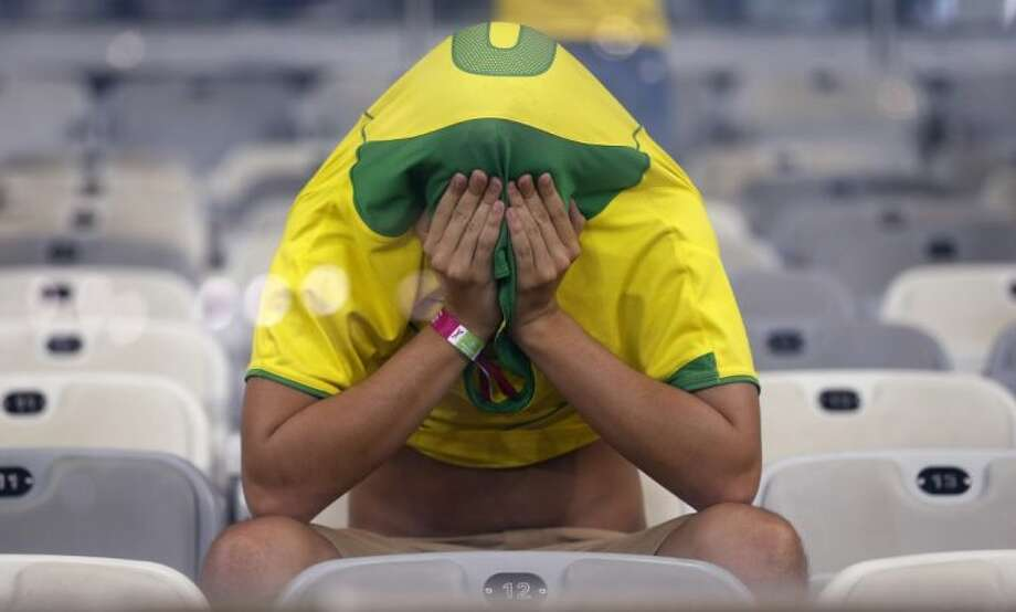 First, Brazil fans suffered through a 7-1 defeat to Germany in the World Cup semifinals on Tuesday. The nightmare continued when rival Argentina won its semifinal match on Wednesday. Photo: Frank Augstein