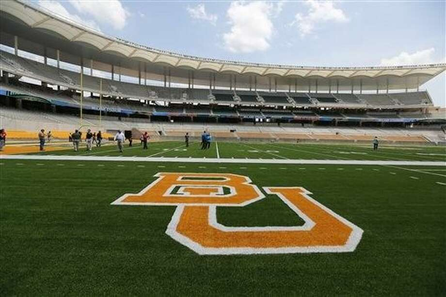 FILE - This Aug 2014 file photo shows the Baylor University logo on the football field at McLane Stadium in Waco, Texas. A long-running spat between the world's largest Baptist school and the Baylor Alumni Association over actions the school claims is hurting its brand is scheduled for a January court showdown over civil lawsuits each has filed against the other. Photo: Rod Aydelotte