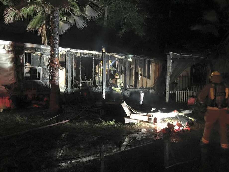 An early Monday morning home fire sent two people to the hospital with burn injuries.