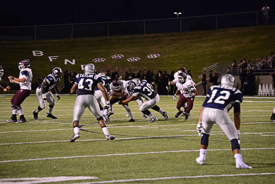 The Cy Ridge defense swarms Cy-Fair quarterback Clayton Kopecky in the Rams' 20-0 win Thursday night at Pridgeon Stadium. Photo: Alexis Hernandez