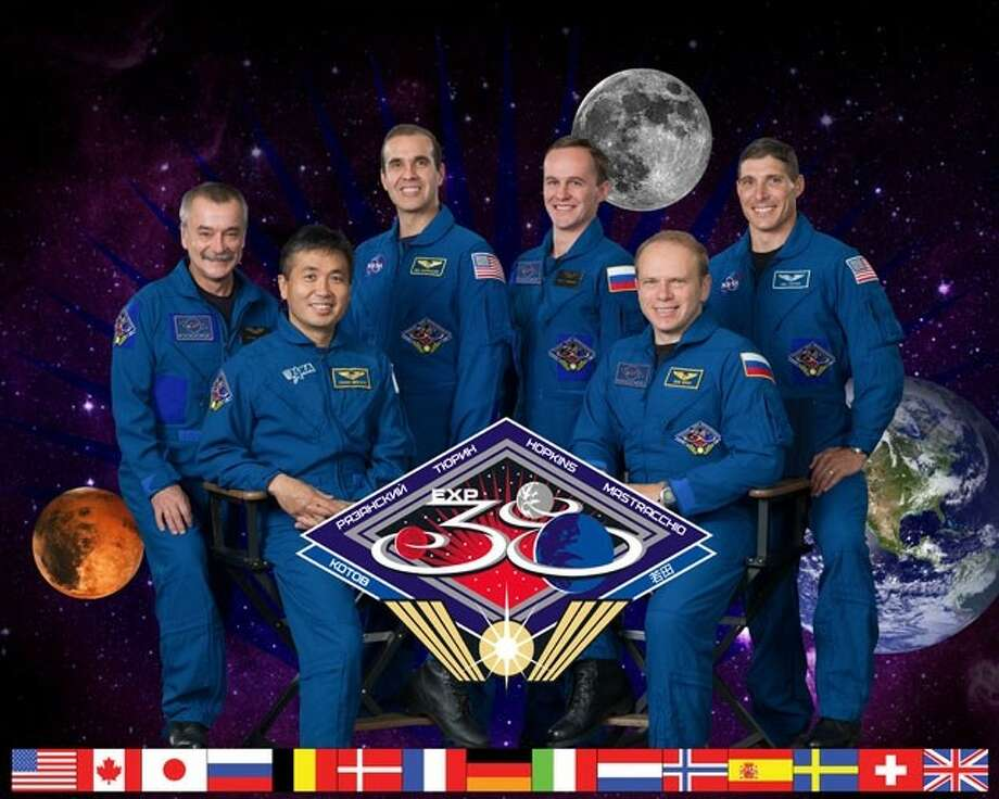 Official portrait for Expedition 38 – Crew members are: (Soyuz 36) – Oleg Kotov, Sergey Ryazanskiy, Mike Hopkins; (Soyuz 37): Mikhail Tyurin, Richard Mastracchio, Koichi Wakata. (Also known as Expedition 38/39). Photo Date: October 3, 2012. Location: Building 8, Room 183 - Photo Studio. Photo: Robert Markowitz / Hasselblad H3D