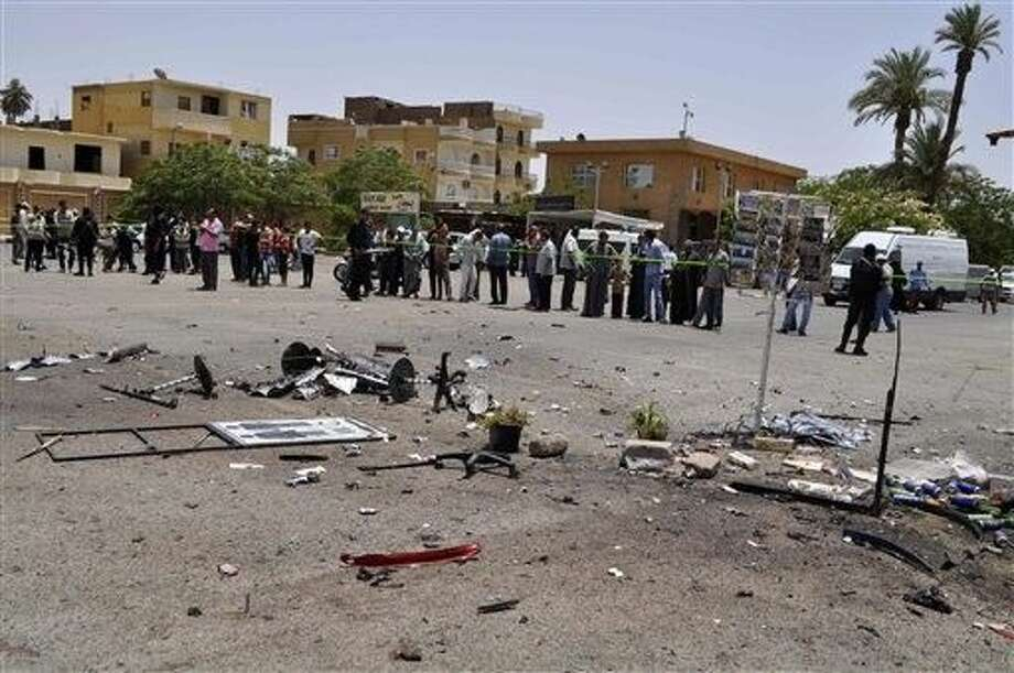 FILE - In this June 2015 file photo, a crowd looks at the site of a suicide bombing, near Karnak Temple in Luxor, Egypt. After a series of stunning militant attacks, the government is pushing through a new controversial anti-terrorism draft bill that would set up special terrorism courts, shorten the appeals process, give police greater powers of arrest and imprison journalists who report information on attacks that differs from the official government line, a judicial official said Monday. Photo: Uncredited