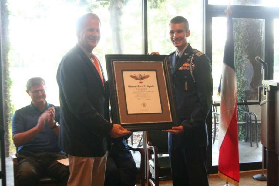 U.S. Rep Poe presents cadet colenol Brandon Cambio with the Carl A. Spaatz Award -- the most prestigious award a Civil Air Patrol cadet can earn. Photo: Nate Brown