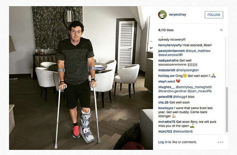In this image released by the world's No. 1 player, Rory McIlroy, McIlroy is shown as he poses on crutches and with his left leg in a medical support. McIlroy ruptured a ligament in his left ankle while playing soccer less than two weeks before the start of his British Open title defense. Photo: HONS