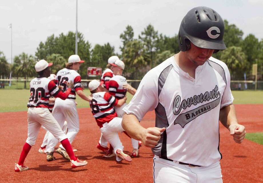 Covenant Christian first baseman Robert Lynch jogs past Rosehill Chrisitian players after losing the TAPPS 1A/2A state championship 9-2 Wednesday at Baseball America in Houston. Photo: Jason Fochtman