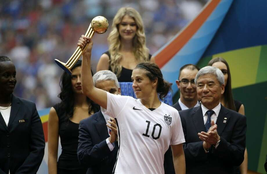 United States player Carli Lloyd holds the Golden Ball trophy for being the tournament MVP after the Americans defeated Japan 5-2 in the World Cup finals on Sunday in Vancouver. Photo: Elaine Thompson