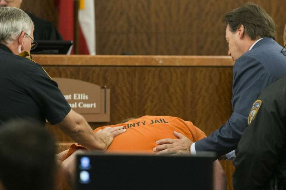 Ronald Lee Haskell collapses as he appears in court on Friday in Houston.
