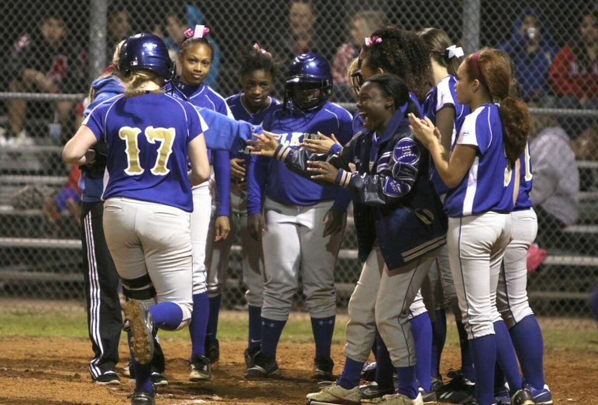 Elkins' Kari Williams comes into home plate after her first-inning home run against Dulles Monday night. (Photo by Alan Warren)