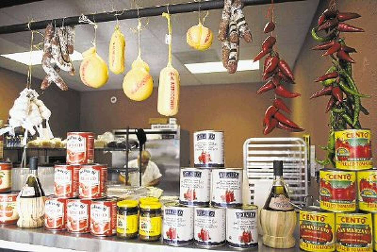 Chef Tony Nicoletta works early in the morning Wednesday preparing for his first day of business at the new Tony's Italian Delicatessen on Texas 105 West. Fresh cheeses and cold cuts are readily available, as well as hot, stuffed Italian sandwiches.