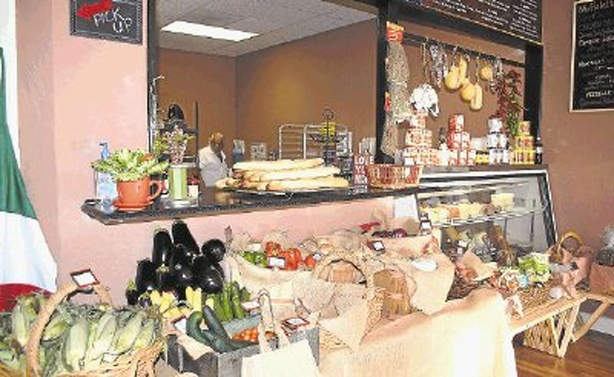 When customers walk into Tony's Italian Delicatessen, they will see the fresh market with eggplant, corn on the cob, tomatoes and garlic. Tony Nicoletta is in the kitchen preparing fresh-baked breads for the day.