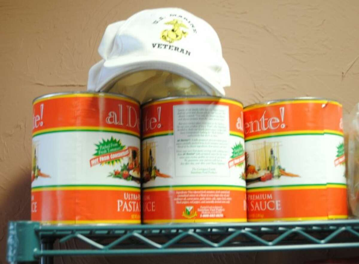 Tony Nicoletta, once a Marine, always a Marine, sets his Marine Veteran cap on the top shelf with the imported pasta sauce.