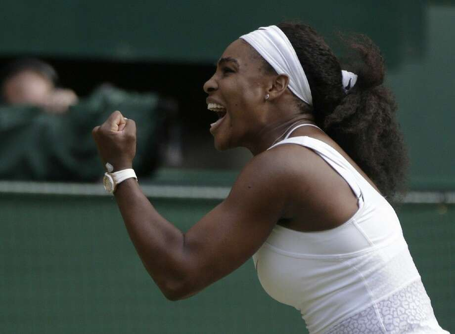Serena Williams celebrates winning the singles match against Victoria Azarenka at the All England Lawn Tennis Championships in Wimbledon, London, Tuesday. Photo: Pavel Golovkin
