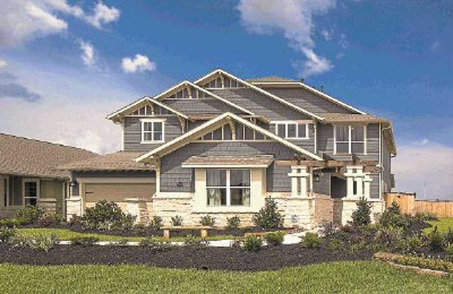 Gracepoint Homes has opened two model homes in Wright's Landing, an 85-acre community two miles east of Interstate 45 near the future Grand Parkway and 13 miles from the new ExxonMobil campus. Home prices are from the $240,000s. / ©2014 Steve Chenn Photography