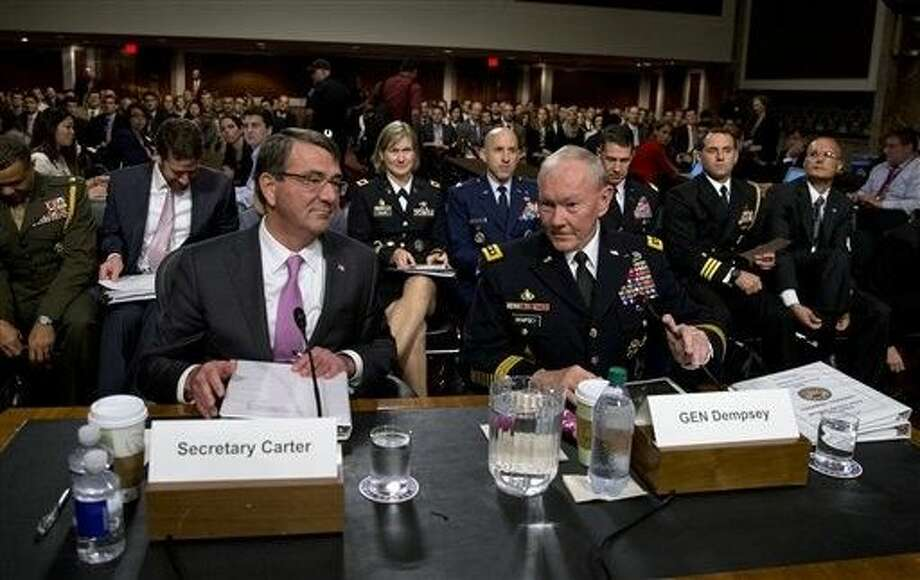 Chairman of the Joint Chiefs of Staff, Gen. Martin Dempsey and Defense Secretary Ash Carter take their seats as they arrive at the Senate Armed Services Committee hearing on Capitol Hill Tuesday about Counter-ISIL (Islamic State of Iraq and the Levant) Strategy. Photo: Carolyn Kaster