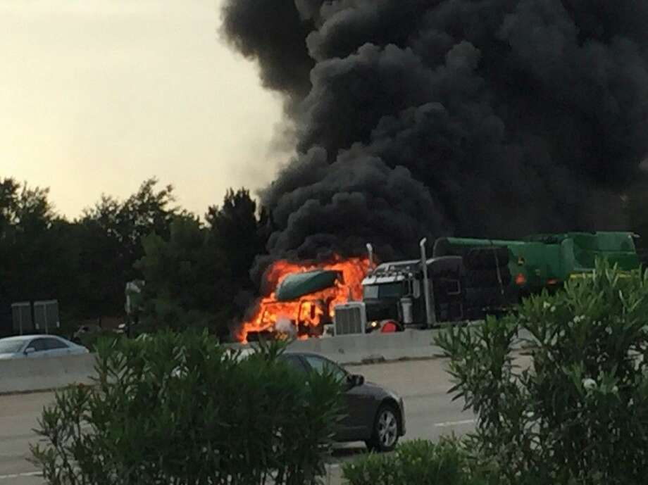 Witnesses reported to fire officials there were two explosions, first from the truck's diesel tank and then from inside the truck's cab at Interstate 45 just north of Texas 242 on Tuesday.