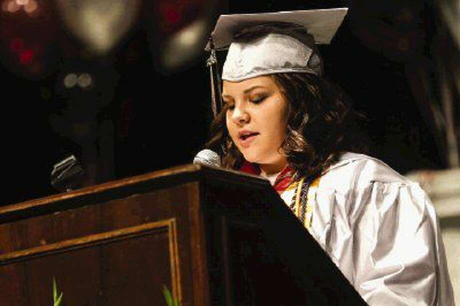 Salutatorian Harli Wilson gives a speech during the W.L. Hauke High School graduation Saturday at Conroe High School.