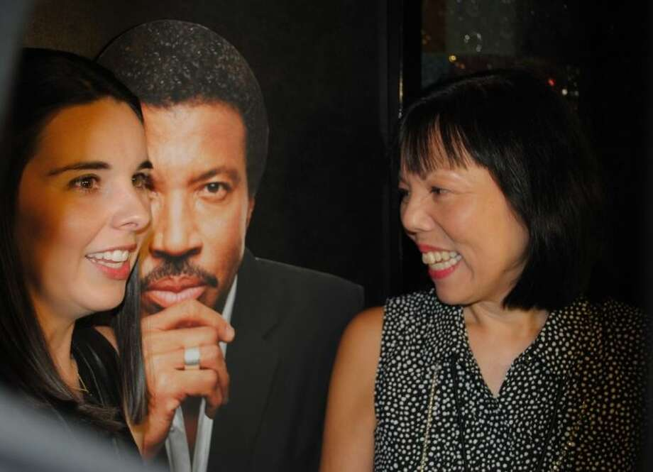 Friends have fun while posing with a cardboard cut-out of legendary song artist Lionel Richie at the Pavilion Partners 2014 Pre-Concert Fundraiser.