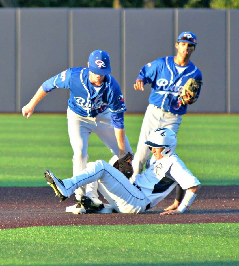 Oak Ridge second baseman Rey Chapa watches as shortstop, Michael Lawson applies the tag to a Jesuit runner during Game 3 of the UIL Region II-6A semifinals at Dallas Baptist University, Saturday May 28, 2016.