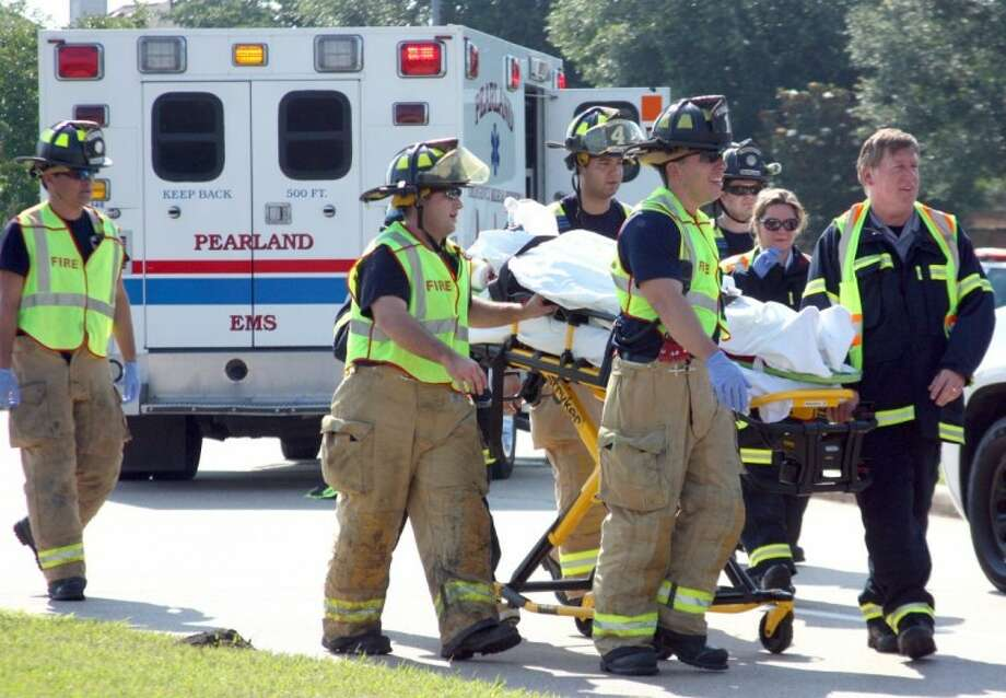 The Pearland Fire Department helped lead the Shattered Dreams assembly. Fire Fighters responded to the scene of an alcohol-related accident reenactment to help students understand the possible tragic outcomes of drinking and driving. Photo: KRISTI NIX