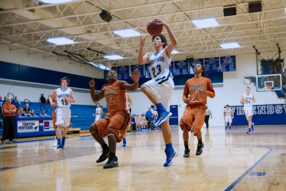 Friendswood's (23) Kelby Schimming, shown in a game earlier this year against Pasadena Dobie, was instrumental this past weekend for the Mustangs, who defeated the No. 2 ranked Class 4A team (San Antonio Brennan) in Texas. Photo: KIRK SIDES