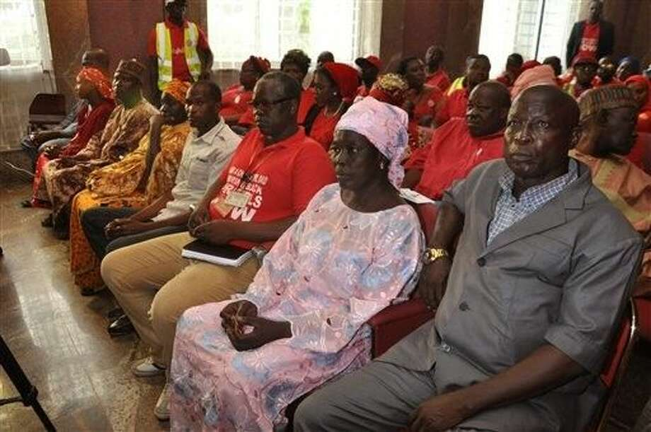 The parents of children abducted by Nigeria's Boko Haram group attend an event linked to the 'Bring Back Our Girls' campaign at the presidential residence in Abuja, Nigeria, Wednesday. Nigeria's Boko Haram are offering to free more than 200 young women and girls kidnapped from a boarding school in the town of Chibok in exchange for the release of militant leaders held by the government, a human rights activist has told The Associated Press. Photo: Olamikan Gbemiga