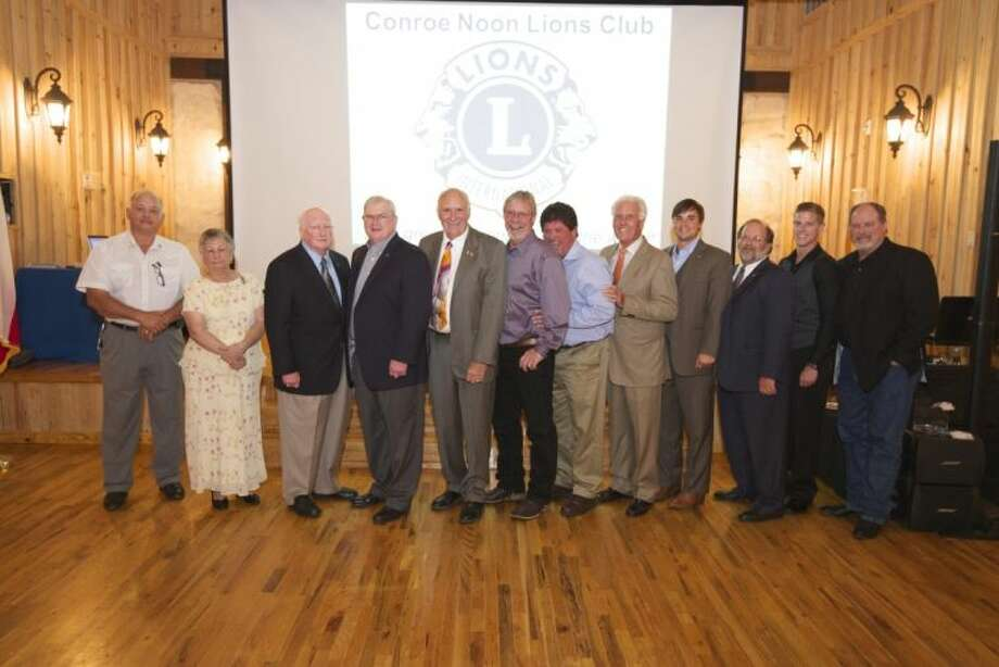 """The slogan used during the 75th Anniversary of the Conroe Noon Lions Club - """"Honoring Lion Legacies of the Past and Celebrating Lion Legacies to Come"""" as shown here with family member generations. Pictured (left to right) are Donnie Cates, Ladoris Cates, Don Buckalew, Donnie Buckalew, Bobby Cantrell, Tim Cantrell, Ricky Morton, Roy Morton, Zach Laake, Gerald Laake, Cody Spence and Don Spence."""