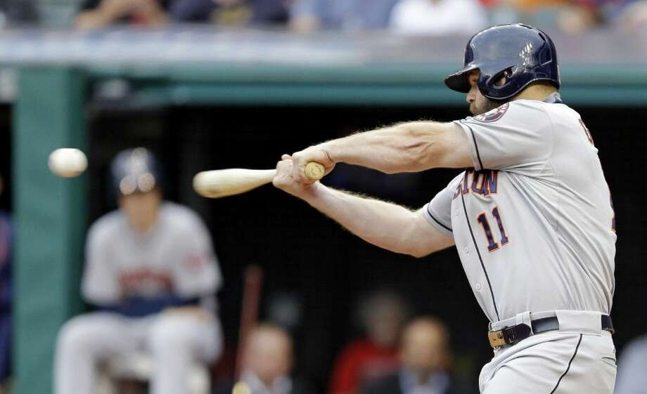 Houston Astros' Evan Gattis hits a two-run home run off Cleveland Indians starting pitcher Trevor Bauer in the first inning Wednesday in Cleveland. Jose Altuve scored on the play. Photo: Tony Dejak