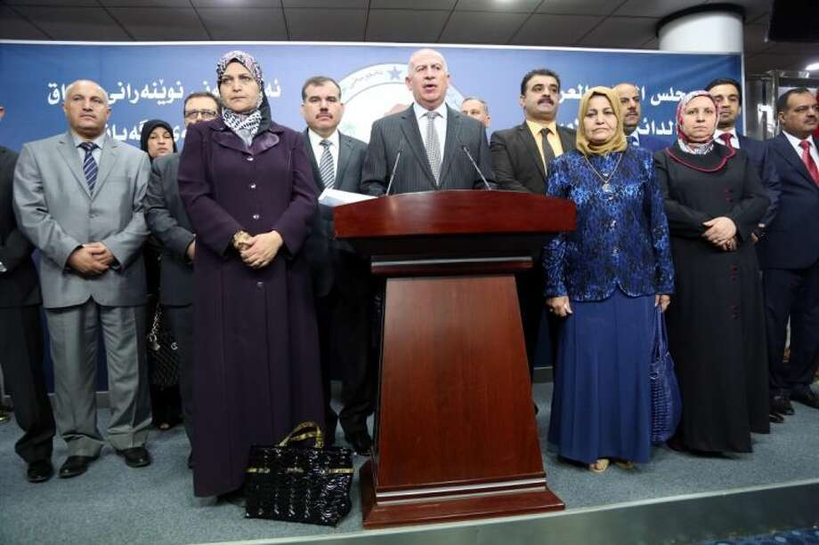 Iraqi former Parliament speaker and the chairman of the Sunni Arab Coalition Osama al-Nujaifi, center, speaks to the media during a press conference in Baghdad, Iraq Sunday. Photo: Karim Kadim