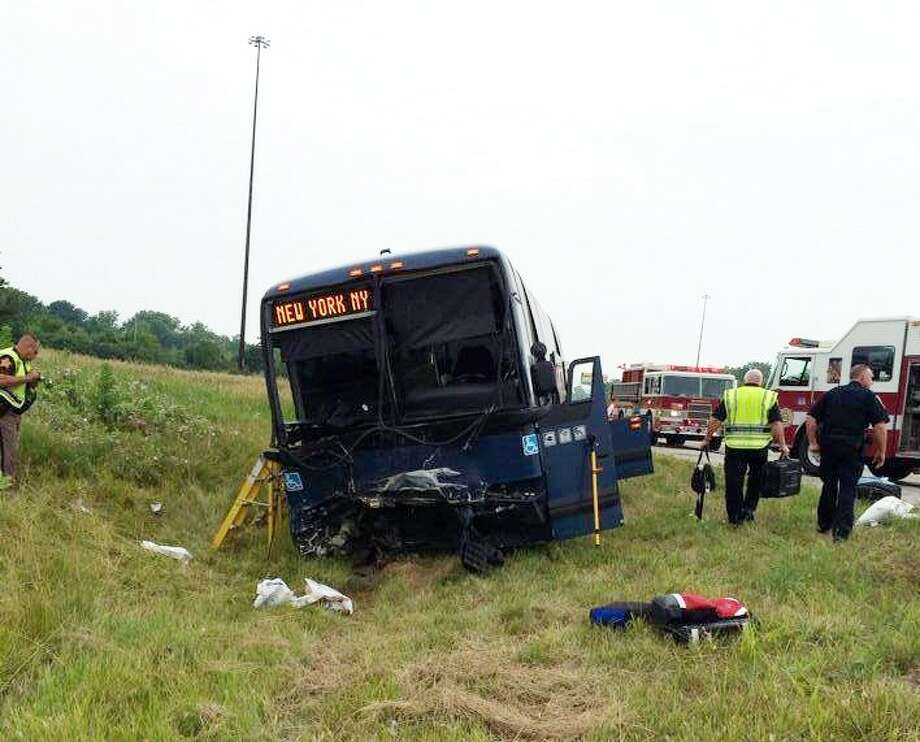 This photo provided by the Wayne County, Indiana Sheriff's Office, emergency personnel respond to the scene of a bus accident on Sunday on interstate 70 near Richmond, Ind. / AP2014