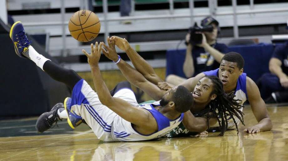 "In this July 7, 2015, file photo, Philadelphia 76ers' Deonte Burton, left, and teammate Richaun Holmes, right, battle with Boston Celtics' Marcus Thornton, center, for a loose ball during the first half of an NBA summer league basketball game in Salt Lake City. The way the NBA records and calls games may be changing. Starting with the Las Vegas summer league, so-called ""hustle stats"" like dives on the floor will start being officially charted. Photo: Rick Bowmer"