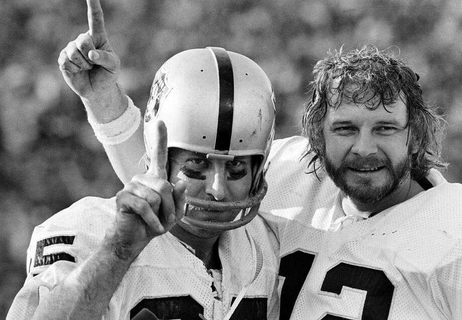 In this Jan. 9, 1977, file photo, Oakland Raiders receiver Fred Biletnikoff, left, and quarterback Ken Stabler each hold up one finger after the Raiders defeated the Minnesota Vikings in the NFL football Super Bowl in Pasadena, Calif. Stabler, who led the Raiders to a Super Bowl victory and was the NFL's Most Valuable Player in 1974, has died as a result of complications from colon cancer. He was 69. His family announced his death on Stabler's Facebook page on Thursday.