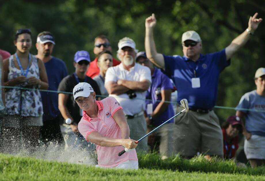 Stacy Lewis hits out of a bunker on the ninth hole during the second round of the U.S. Women's Open golf tournament at Lancaster Country Club, Friday in Lancaster, Pa. Photo: Frank Franklin II