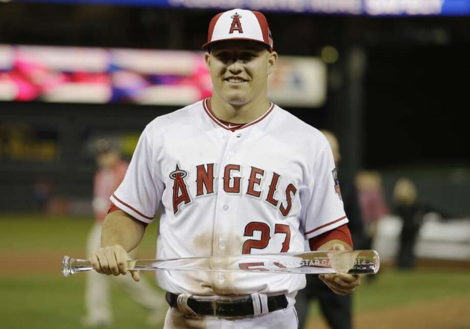 Outfielder Mike Trout of the Los Angeles Angels of Anaheim holds the MVP trophy after helping the American League to a 5-3 victory over the National League in the MLB All-Star game on Tuesday in Minneapolis. Photo: Jeff Roberson