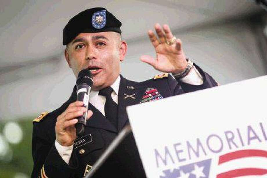 David Yebra, retired Army Lt. Col., speaks during the Memorial Day festivities Saturday at Town Green Park.