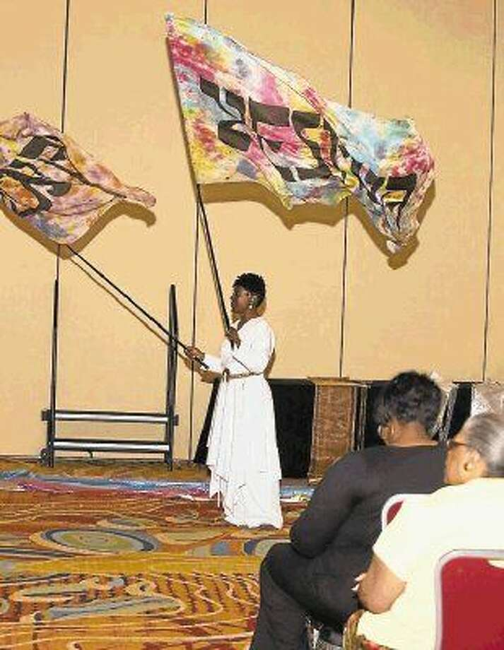 Flag bearers wave flags during worship Friday night at the 2014 SOAR Conference.