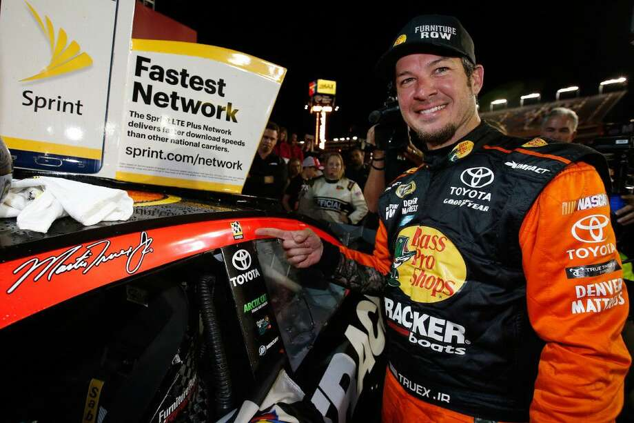 Martin Truex Jr., driver of the #78 Bass Pro Shops/Tracker Toyota, poses with the winner's decal after winning the NASCAR Sprint Cup Series Coca-Cola 600 at Charlotte Motor Speedway on Sunday in Charlotte, North Carolina. Photo: Todd Warshaw
