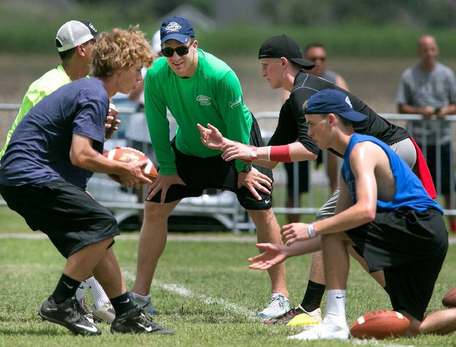 In this photo taken on Friday, July 10, 2015, Peyton Manning works with aspiring quarterbacks, receivers, running backs and tight ends as they practice and learn football fundamentals during the Manning Passing Academy at Nicholls State University in Thibodaux, La.. The 20th annual camp runs from July 9-12 at Nicholls State University with the perennial leaders - former New Orleans Saints quarterback Archie Manning and his three sons, Cooper and Super Bowl winners Peyton and Eli. Photo: Ted Jackson