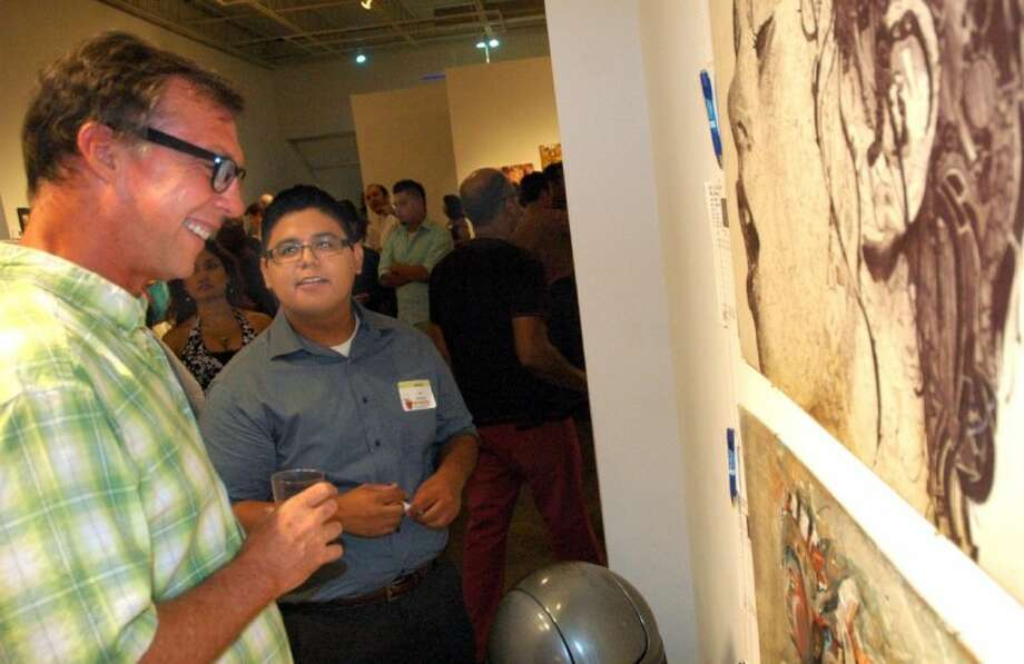 Artist Dan Dunn (left) talks with emerging artist Luis Jimenez Saturday at Newpring's Define the Future event at Peveto Gallery. Photo: Rusty Graham