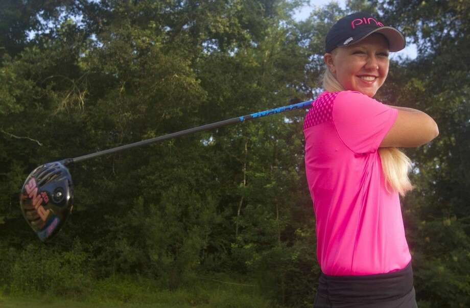 Montgomery's Hailee Cooper smiles on a practice follow-through during a photo shoot on Friday morning at the Grand Pines Golf Club north of Lake Conroe. Cooper, 15, won the UIL state golf individual medalist title on April 28 in Georgetown. Photo: Jason Fochtman