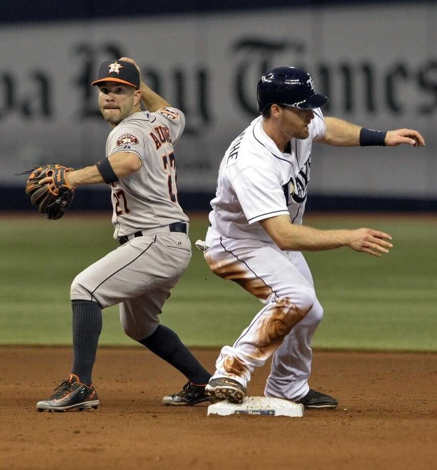 Houston Astros' Jose Altuve, left, forces out Tampa Bay Rays' Logan Forsythe at second base and throws to first to complete a double play during the sixth inning Saturday in St. Petersburg, Fla. Photo: Steve Nesius
