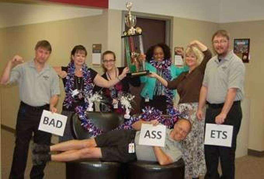 """Team members from the Montgomery County Hospital District """"Bad Assets"""" pose for a Walk Across Texas photo. The team finished 15th with 2,198.19 miles recorded."""