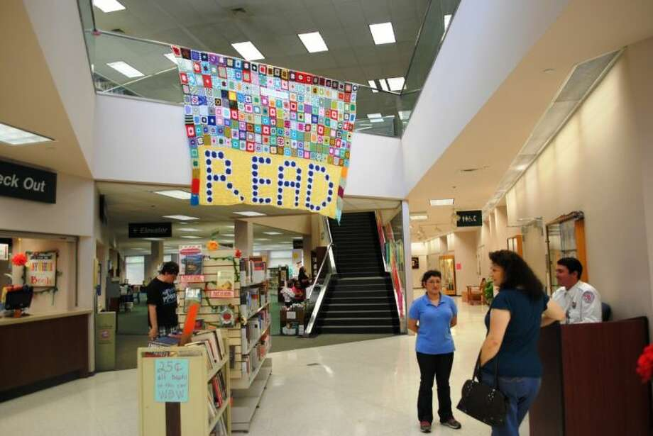 "As library patrons enter the Central Library in Conroe, they will be met with a large welcoming quilt that spells ""Read."" The library is holding a special reception Friday for the public to celebrate 20 years of service at its current location."